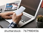man using cell phone and laptop ... | Shutterstock . vector #767980456