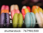 colorful macaroons set on black ... | Shutterstock . vector #767981500
