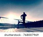morning runner in tall black... | Shutterstock . vector #768007969