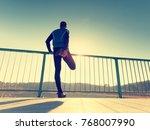 the runner in tall black... | Shutterstock . vector #768007990