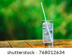 glass glass. mineral water with ... | Shutterstock . vector #768012634