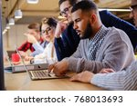 young colleagues discussing...   Shutterstock . vector #768013693