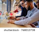 young colleagues discussing...   Shutterstock . vector #768013738