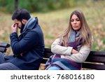 couple sitting in park having... | Shutterstock . vector #768016180