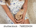 Stock photo girl with a favorite kitten young beautiful girl is holding a red kitten girl with long hair 768020434