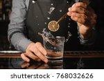 bartender decorating a clear... | Shutterstock . vector #768032626