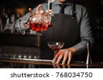 barman in a tie and apron... | Shutterstock . vector #768034750