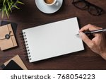 top view of businessman writing ... | Shutterstock . vector #768054223