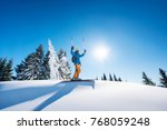 low angle shot of a cheerful... | Shutterstock . vector #768059248
