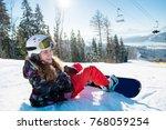 smiling female snowboarder... | Shutterstock . vector #768059254