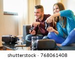 happy friends playing video... | Shutterstock . vector #768061408