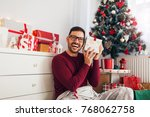 smiling young man listening in... | Shutterstock . vector #768062758
