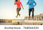 Stock photo athletic couple of friends running outdoor fitness happy people doing sport at sunset healthy 768066334