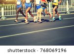 female and male marathon... | Shutterstock . vector #768069196