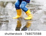 close up of kid wearing yellow... | Shutterstock . vector #768070588