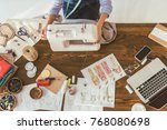 cropped image of seamstress... | Shutterstock . vector #768080698