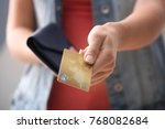 young woman with credit card... | Shutterstock . vector #768082684