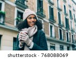 young black woman drinking... | Shutterstock . vector #768088069
