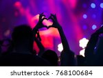 crowd at concert   heart shaped ... | Shutterstock . vector #768100684