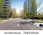 empty highway with cityscape... | Shutterstock . vector #768103324