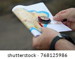 man holding map.athlete uses...   Shutterstock . vector #768125986