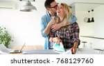 young couple at home doing... | Shutterstock . vector #768129760