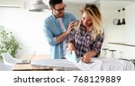 young couple at home doing... | Shutterstock . vector #768129889