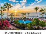 sunset on the adeje coast ... | Shutterstock . vector #768131338