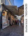 Small photo of Quebec City, Canada - October 22, 2017 : Tourists and artists in alleyway of old city Quebec.