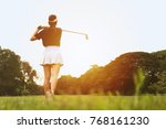 woman golf player swing shot on ... | Shutterstock . vector #768161230