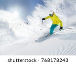 skier skiing downhill during... | Shutterstock . vector #768178243