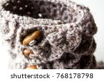 Small photo of Knitted boot with togs