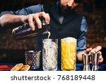 elegant bartender pouring fresh ... | Shutterstock . vector #768189448