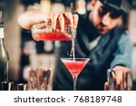 barman preparing and pouring... | Shutterstock . vector #768189748