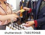 closeup hand of customer paying ...   Shutterstock . vector #768190468