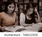 two female student reading a... | Shutterstock . vector #768212320