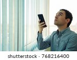 young man using a smartphone in ... | Shutterstock . vector #768216400