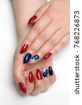 red blue nails with a design... | Shutterstock . vector #768226873