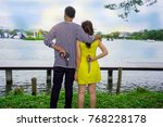 Small photo of Enemy couple, unfaithful lover, affair family, cheating husband and wife, man holding woman shoulder looking forward but both hide holding gun and knife behind. Love hate relationship concept.