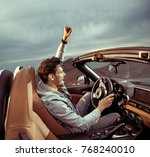 young handsome man posing in a... | Shutterstock . vector #768240010