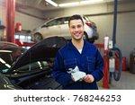 car mechanic in auto repair shop | Shutterstock . vector #768246253