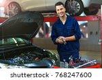 car mechanic in auto repair shop | Shutterstock . vector #768247600