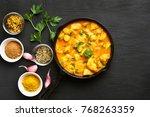 chicken curry on dark stone... | Shutterstock . vector #768263359