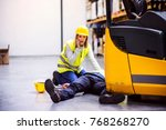warehouse workers after an... | Shutterstock . vector #768268270