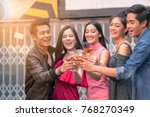 smiling friends toasting with... | Shutterstock . vector #768270349