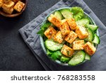 fried tofu salad with cucumbers ... | Shutterstock . vector #768283558