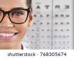 in an optical store  a boy... | Shutterstock . vector #768305674