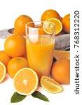 glass of orange juice with... | Shutterstock . vector #768312220