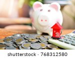 house model on calculator and... | Shutterstock . vector #768312580