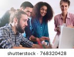 young multiethnic business team ... | Shutterstock . vector #768320428